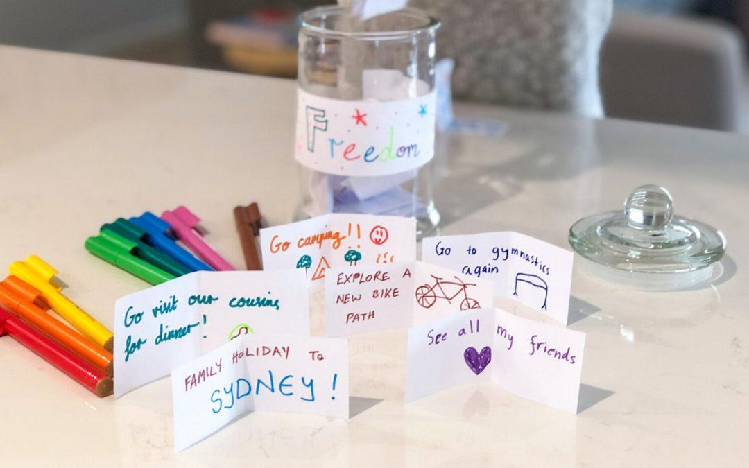 Girl placing notes in jar