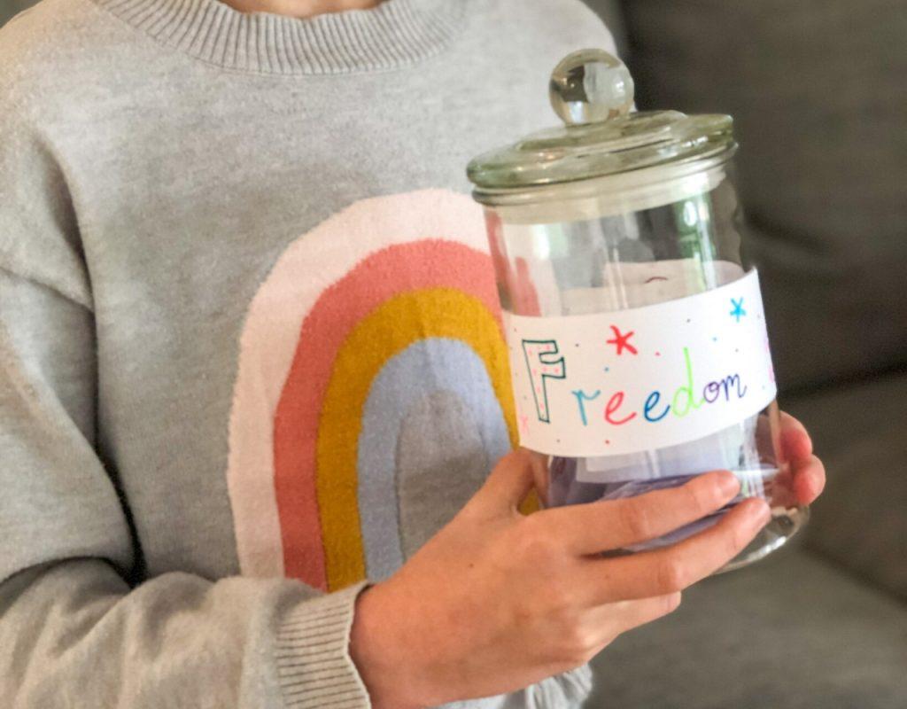 Girl Holding Freedom Jar