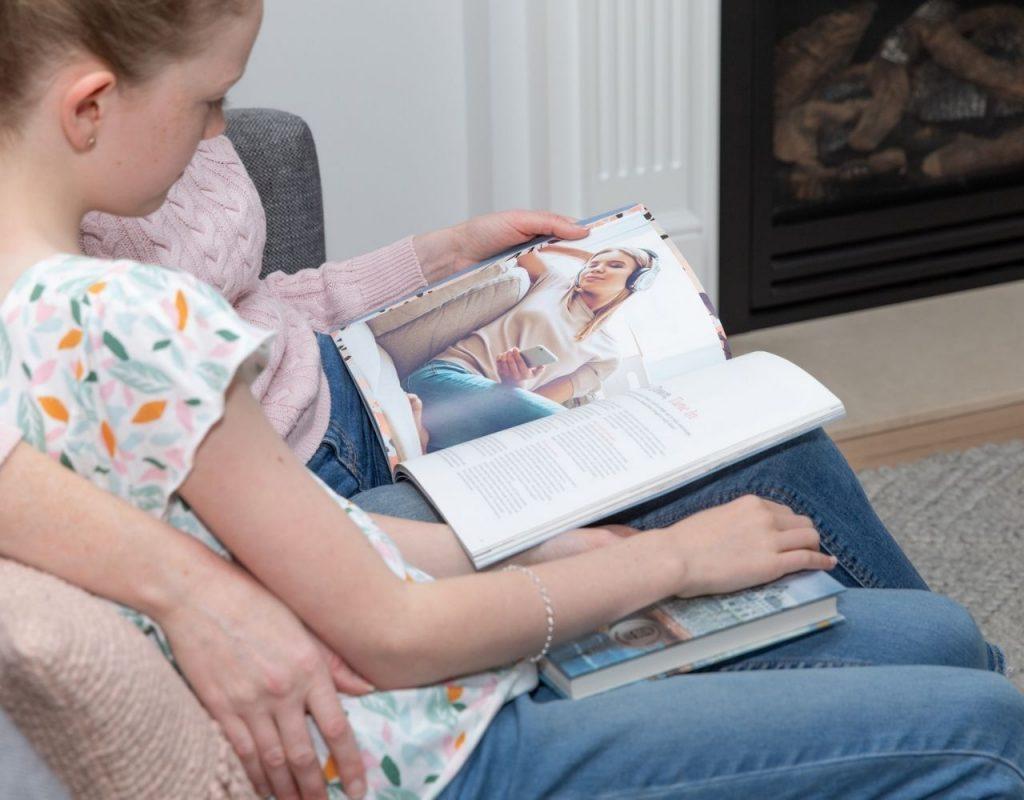 Tween girl reading magazine